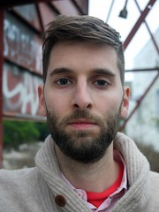 March 2015 (tomtomklub) Tags: street red brown white house selfportrait man sign vertical metal shirt 30 beard t outside graffiti sweater louisiana downtown cloudy background steel painted neworleans gray young tan khaki first overcast billboard diagonal shawl framing collar month facial marigny selfie checked