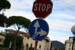 Clet and his traffic signs (part1) (ron Sebestyn) Tags: road street blue red italy white streetart art canon photography 50mm photo florence paint artist traffic streetsign streetphotography spray stop tuscany graff trafficsign clet