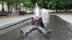 Headless Man in Fountain | Square Victoria, Montreal (Exile on Ontario St) Tags: montral fountain decapitated headless disembodiedhead body montreal fontaine water publicart installation silly surprising eau publique jetwater jet jets waterjet jetdeau jetsdeau squarevictoria quartier international district placevictoria shocking victoriasquare place square victoria urban urbain ville city vieuxmontral oldmontreal summer t person human clothes art public artpublic sitting drenched mouill wet tremp soaked soak vtements linge dcapit sans tte missing drench disembodied corps tronc squirting squirt sprinkler neck cou tranch coupe tt chopped