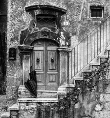After the Rain (nokkie1) Tags: italy village rain umbrella door texture old stairs black white contrast
