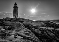 The Iconic Lighthouse at Peggys Cove (kenmojr) Tags: 18105 2016 atlantic atlanticprovinces attraction calm canada cloud clouds coast coastal cove d7000 eastern famous fishing halifax hrm iconic july kenmorris kenmo lighthouse maritime maritimeprovinces maritimes nikkor nikon ocean peggys peggyscove quiet rocky sea shore sightseers sightseing skies sky still summer tourism tourist tourists vacation village water blackwhite blackandwhite reflection
