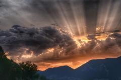 Sunbeams during sunset at Iseo Lake (Italy) (Jaco Verheul) Tags: sunset sunbeam mountain orange nikon d5100 1685mm ngc italy iseo cloud landscape sky