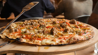 Goodfella Pizza | tomato sauce, mozzarella, sausage, caramelized onion, roasted pepper, garlic