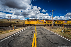Union Pacific in Toponas, CO (Brandon Townley) Tags: trains railroad up unionpacific clouds sky polarizer motionblur road colorado signal railroadcrossing
