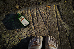 Remnants (Melissa Maples) Tags: ludwigsburg germany deutschland europe apple iphone iphone6 cameraphone dawn morning autumn me melissa maples selfportrait woman shoes feet fivefingers vibram alcohol bottle jgermeister pavement grey jgermeister