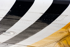 Underwing (CarbonNYC [in SF!]) Tags: b29 dwight fifi monterey airplane bomber flight flightseeing lines paint painted plane planewing stripes vintage wing yellow