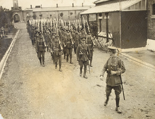British soldiers marching out of a barracks