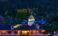 Nightfall in Ouray (Aubrey Stoll) Tags: ouray mining gold silver county sanjuanmountains conifers evergreens pinetrees slopes redmountain prospectors historical tower hotel clock nightshot colours motel colorado telluride ridgway tourismswitzerlandofamerica trees branches visitors travellers tourists skiing rocks hills houses electricwires site sightseeing aspen