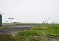 F-GHOC & D-IPOD parked. (aitch tee) Tags: cardiffairport aircraft fghoc dipod parkedonthecambrian ttail signatureaircrafthandling cwlegff maesawyrcaerdydd walesuk