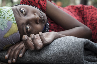 A young Somali girl arrived in Kakuma a few days ago with her family. As a result of a heart ailment she can't move much and lies on a thin blanket on the ground.