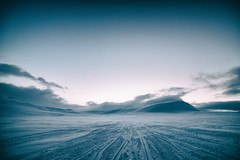 Cold landscape (Tommy Høyland) Tags: voyage travel blue winter mountain snow cold art tourism ice nature beautiful weather sport norway rock clouds landscape evening norge path horizon extreme tracks svalbard arctic adventure journey climber tracking spitsbergen snowmobile endless
