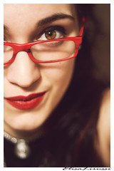 Red details (Elisa Lirussi) Tags: red portrait italy woman selfportrait cute art girl beauty smile face look rock canon eos glasses donna eyes italian italia close arte style lips occhi sguardo autoritratto sorriso lipstick brunette rosso ritratto stile viso bellezza ragazza occhiali rossetto labbra 600d