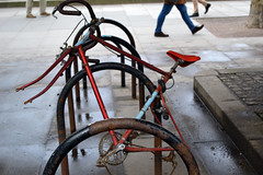 Apart (Millykatemacky) Tags: london broken bicycle wheel rust south bank racing chain together forgotten left tyre apart unloved disfigured dismantled