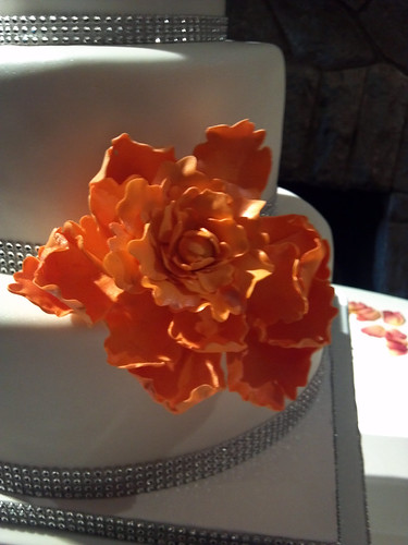 """A large orange sugar flower to decorate this wedding cake. • <a style=""""font-size:0.8em;"""" href=""""http://www.flickr.com/photos/50891271@N03/16160563028/"""" target=""""_blank"""">View on Flickr</a>"""