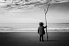 Roman Inuit (Luca Rossini) Tags: sea portrait bw beach girl fuji shore fujifilm x100t