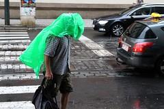 Go green (tomavim) Tags: raincoat rain green street