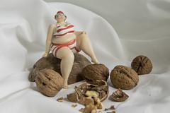 the nut cracker (Mark Rigler UK) Tags: fat lass girl plus size model scale toy nut coconut shell walnut