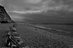 A British Summer ! (Neil. Moralee) Tags: neilmoralee beer devon beach coast pabbles deck chair deckchair sea ocean clouds stormy wet cold windy cliff south dog summer britain british holiday deserted empty black white bw mono monochrome blackandwhite moody neil moralee nikon d7100 vacation outdoor
