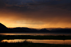 Stormy sunset over the Shuswap (windyhill623) Tags: storm stormcloud stormlight sunset summer landscape skyscape sky dusk silhouette water lake marsh mountain mountainrange eveninglight evening shuswaplake salmonarm britishcolumbia beautifullight glow orange outdoor