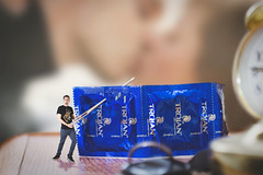 Self portrait – Life is full of little surprises! (MattysFlicks) Tags: condoms prophylactic prank kissing lover couple sewing needle pin poke poking holes surprise surprises portrait photo photography composite illustrations macro night stand table nightstand nighttable end endtable clock trojan lube lubed ribbed flavored blue shiny package wood grain person mischief bed bedroom tiny intruder shadows skin disease hiv aids prevention contraceptive highlight glint star man woman jerk idiot sony alpha ilce 6000 a6000 ilce6000 minolta celtic 50mmf35 wrokkorx 28mm f28