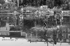 Play the game (Alberto Gravagno) Tags: nice france francia bambini palla ball kids play game gioco garden giardino water street photography riflesso momenti moment black white travel