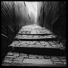 This way to the castle. (S Cansfield) Tags: durham steps dark panasonic lumix gx1 20mm f17 microfourthirds passage alley buildings texture mono