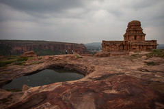 on the North cliff of Badami (Scalino) Tags: india karnataka travel trip badami durga temple heritage site chalukyas chalukya cliff pond cloudy