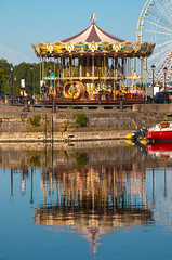 fairground reflections, carousel (merry-go-round) in the water of the Vieux Bassin (Old Harbour), Honfleur, Normandy, France (grumpybaldprof) Tags: vieuxbassin oldharbour honfleur normandie normandy france quaistecatherine quaiquarantaine quai quaistetienne stecatherine lalieutenance quarantaine water boats sails ships harbour historic old ancient monument picturesque restaurants bars town port colour lights reflection architecture buildings mooring sailing stone collombage halftimbered yachts carousel merrygoround reflections waterreflections wetreflectionsfunfair tamron 16300 16300mm tamron16300mmf3563diiivcpzdb016