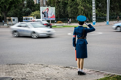 Traffic warden salutes offical car in Pyongyang, North Korea (DPRK) (tommcshanephotography) Tags: adventure asia communism dprk democraticpeoplesrepublicofkorea expedition exploring kimilsung kimjungil kimjungun northkorea pyongyang revolution secretcompass travel trekking