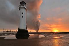 Perch Rock blazing skies (pentlandpirate) Tags: liverpool seaforth docks fire scrapmetal newbrighton perchrock lighthouse merseyside dawn sunrise smoke