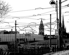 urban power (Harry Halibut) Tags: park bw tower castle clock blancoynegro branco buildings square town hall blackwhite cathedral noiretblanc sheffield roundabout o2 tram preto junction spire cables wires academy zwart wit weiss bianco blanc nero overhead allrightsreserved supertram noire  schwatz    contrastbysoftwarelaziness electrcicty sheff1501041858 2015andrewpettigrew