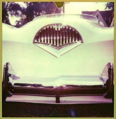 Kaiser Lips ([jonrev]) Tags: show camera old sun color classic film sports car vintage polaroid gold chrome shade frame land instant kaiser grille edition 660 darrin impossible autofocus px680