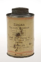 Zenobia Talcum Powder - TWCMS:G3781 (Tyne & Wear Archives & Museums) Tags: firstworldwar ww1 worlife packaging household zenobiatalcumpowder firstworldwarproductpackaging wartime homefront tin yellow orange black blue flowerdecoration manufacturing production industry industrialheritage artanddesign abstract loughborough england unitedkingdom 1914 18 191418 digitalimage colourphotograph consumerism retail sales display neutralbackground fascinating interesting unusual white paper text mark wear corrosion letters advertising archives