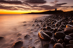 For those about to climb over these rocks (we salute you) (Paul_Nelson) Tags: longexposure sea castle water rock sepia sunrise canon coast rocks slow northumberland coastal filter le lee nd shutter 5d grad mkiii dunstanburgh