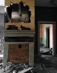 Left Behind:  Inside an Abandoned House, Edgecombe County, North Carolina (EdgecombePlanter) Tags: light shadow stilllife colors trash nc sad decay south northcarolina haunted creepy spooky southern carolina haunting dilapidation mantel leftbehind collapsing onemanstrash
