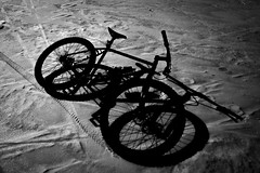 He Just Floated Away (bjornery) Tags: winter blackandwhite bw lake snow ice monochrome bike bicycle contrast frozen highcontrast ethereal fujifilm surly rapture ether 1x1 lakeoftheisles astralprojection xt1 tvpick