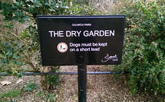 watering can't (dr_loplop) Tags: park trees plants dogs sign garden kept weeds earth dry ground soil bark short be chip must lead ona shrubs southwark dulwich planting mulch nowmoveon nodogshere