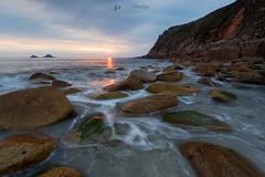 Orange splash (T_J_P) Tags: ocean sunset sea beach water clouds coast rocks cornwall tide cliffs coastal tidal cornish stjust porthnanven
