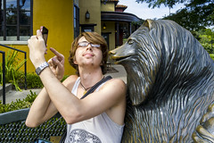 Showing Off His Pokemon (Reg|Photography4Lyfe) Tags: portrait portraiture boy statue sculpture bear man gay sleeveless phonephotography cameraphone 2016 rio gaithersburg md lgg4