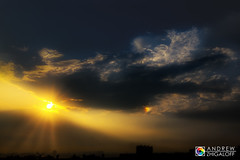 sunrise (Andrew V. Zhigaloff) Tags: sun cloud sunrise morning dawn sky skyline architecture city cloudscape sunlight yellow orange light east reflection overcast outdoors haze cityscape dramatic district blue landscape