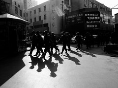 keep on truckin' (-{ ThusOriginal }-) Tags: 2009 bw blackandwhite china city digital grd3 grdiii march nanjing people ricoh shadow soldier street thusihaveseen winter