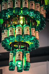 Mike Driscoll 2016 - Whiskey Chandelier (Michael Driscoll Jr.) Tags: whiskey jameson irish green chandelier bottle glass multiples repetition light lamp glow drink alcohol whisky hanging closeup