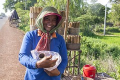 A Beautiful Kralan Seller (SAM601601) Tags: kralan woman vendor seller sam601601 cambodia route64 beautiful bamboo