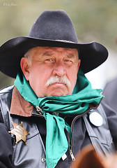 Don't Mess With A Man With A Badge (wyojones) Tags: look cowboy pin texas expression coat blueeyes houston scout parade badge mustache bandana cowboyhat horseback trailride grayhair houstonlivestockshowandrodeo leathercoat lhat wyojones houstonlivestockshowandrodeoparade
