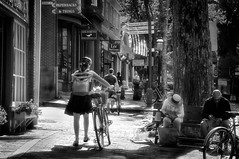 bicycles (JimfromCanada) Tags: bw sun monochrome bike bicycle glow afternoon walk peaceful sunny safety sidewalk nantucket serene care careful