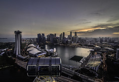 A l t i t u d e (Blunt_Art) Tags: altitude high up nice view city dusk hour motion cycle citylife cityscape skylines beautiful tall buildings architecture structure marinabaysands d5300 dawn nikon tokina 1116 wide hdr light lights flight capsule wheel breathtaking stunning lift lifted life time moment brief