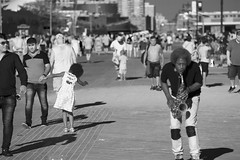 music at the beach (Litratistica Images NYC) Tags: beach blackandwhite boardwalk coneyisland dancing litratisticaimages littlegirl nyc outdoor people saxophone seaside streetmusician streetphotography canoneos5dmk2 canon70200mm
