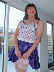 Without looking (Paula Satijn) Tags: hot sexy stockings girl smile happy purple sweet silk adorable skirt tgirl transvestite satin miniskirt gurl silky
