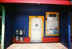 Colorful business (jfpj) Tags: california blue red film yellow store lowresolution fuji toycamera plastic gilroy storefronts plasticcamera trashcam plasticlens fuji400film holga280