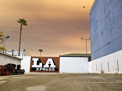 Sand Fire Skies 2 (ijp01) Tags: california losangeles hollywood sandfires cityscape parkinglot signage pavement buildings palmtrees smoke ash sky clouds urban abandoned